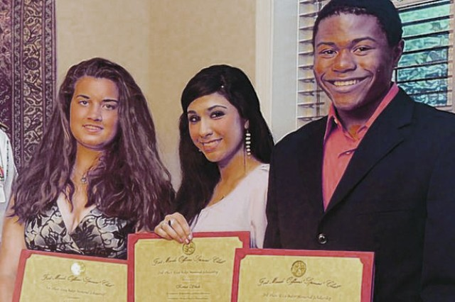 Annalisa Irby and Kinza Shah, both graduating seniors at Meade High School, and Roger Isom Jr., a graduating senior at Broadneck High School in Annapolis, accept the Officers' Spouses' Club's Etta Baker Memorial Scholarship at last year's award ceremony.