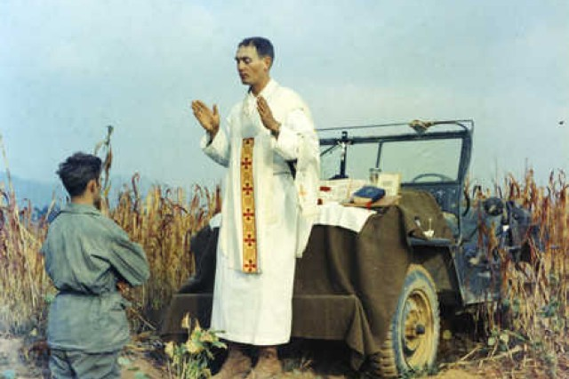 President Barack Obama announced March 11, 2013, that Chaplain (Capt.) Emil J. Kapaun will be awarded the Medal of Honor posthumously, April 11, for his actions leading up to his capture as a prisoner of war in North Korea. Here, Kapaun prays with a Soldier during the Korean War.