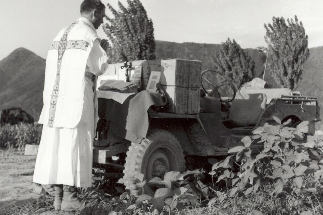 President Barack Obama announced March 11, 2013, that Chaplain (Capt.) Emil J. Kapaun will be awarded the Medal of Honor posthumously, April 11, for his actions leading up to his capture as a prisoner of war in North Korea. Here, Kapaun prays at a makeshift altar on his jeep during the Korean War.