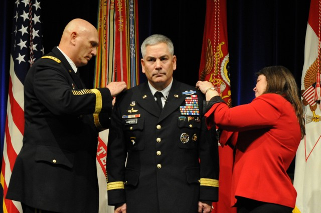 Army Chief of Staff Gen. Ray Odierno and Ann Campbell place four-star shoulder boards on Gen. John F. Campbell, who afterward was sworn in as the 34th Army vice chief of staff at the Pentagon, March. 8, 2013.