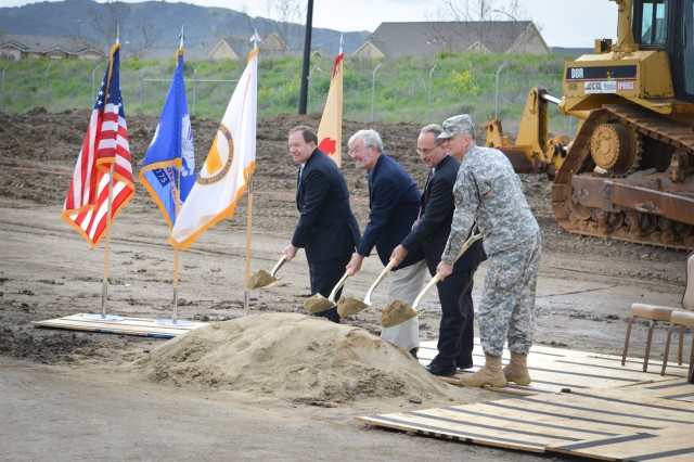 "(From left) Mr. Addison ""Tad"" Davis, Mr. Don Biddle, Mr. Joe Guerra, and Lt. Col. (P) David James break ground during a ceremony March 6, 2013 commemorating the first of six phases of construction at U.S. Army Garrison Camp Parks Reserve Training center in Dublin, Calif. The U.S. Army Corps of Engineers Sacramento District's real estate office is overseeing a 180-acre transfer of land in exchange for an estimated $66 million in modern facilities for Camp Parks over the next several years""the largest Army Reserve real property exchange agreement in Department of Defense history.  (U.S. Army photo by Todd Plain/Released)"