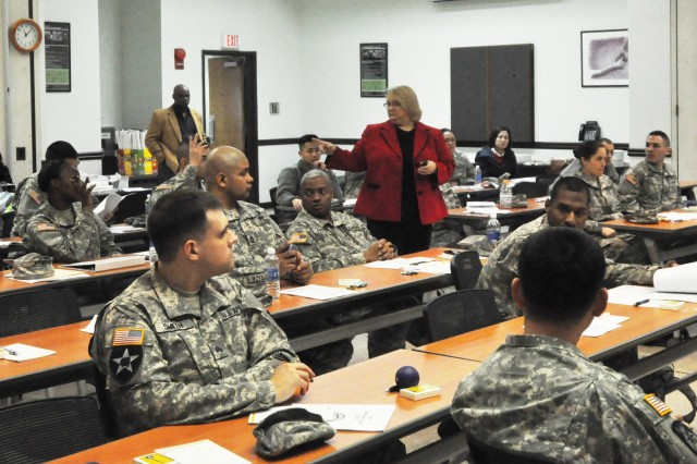 Ann Mancillas, financial readiness manager and Army Emergency Relief officer, explains the Army Emergency Relief program and its many benefits during the annual 2013 Army Emergency Relief Campaign here, Mar. 1. ( U.S. Army photo by Sgt. Kevin Frazier)