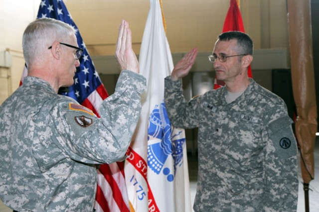 Maj. Gen. Peter Lennon (left), commanding general, 377th Theater Sustainment Command, administers the oath of office to Brig. Gen. Michael Mann, commander, Deployment Support Command, during Mann's promotion ceremony Saturday. (U.S. Army photo by Staff Sgt. Sheila Holifield)