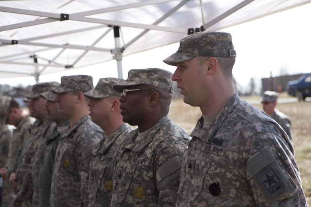Army Reserve recruiters from the Raleigh Recruiting Battalion sing the Army Song to conclude a ground breaking ceremony for a new Army Reserve Center in McLeansville, N.C. on March 2.