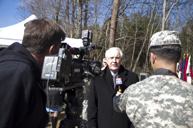 Army Reserve Ambassador Johnny Dwiggins talks to Fox reporter Brian Rainey of WGHP 8 after a ground breaking ceremony for a new Army Reserve Center in McLeansville, N.C. on March 2.