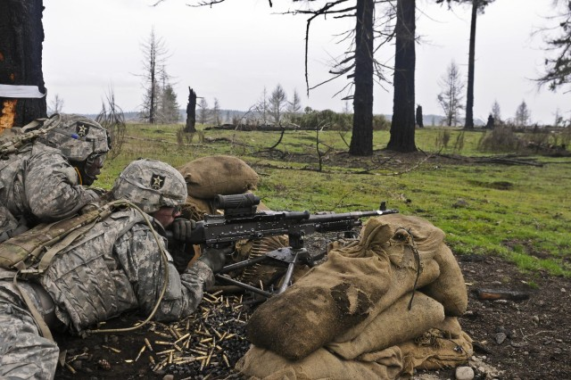 U.S. Soldiers with Golf Company, 52nd Infantry Regiment, 4th Stryker Brigade Combat Team, 2nd Infantry Division fire at a simulated enemy position with an M240B machine gun during squad react-to-contact training at Joint Base Lewis-McChord, Wash., March 5, 2013.  (U.S. Army photo by Spc. Loren Cook/Released)