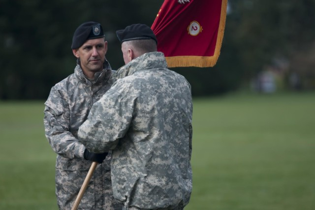 U.S. Army Lt. Col. Kolin Bernardoni, left, the outgoing commander of the 2nd Battalion, 17th Field Artillery Regiment, passes the unit's flag to Col. Barry Huggins, the commander of the 2nd Stryker Brigade Combat Team, 2nd Infantry Division, during a change of command ceremony at Joint Base Lewis-McChord, Wash., March 7, 2013.  (U.S. Army photo by Staff Sgt. Bryan Dominique/Released)