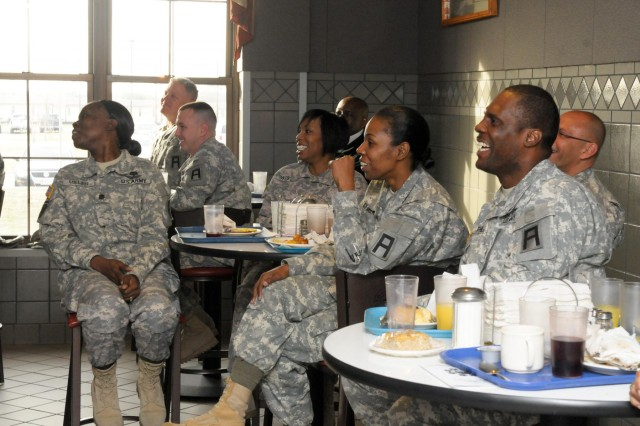 First Army Division West soldiers laugh during a humorous sermon given by Dr. Dennis Swanberg in a division prayer breakfast at Theodore Roosevelt Dining Facility on Fort Hood, Texas, March 4. Division West had the prayer breakfast to promote faith and resiliency. (Photo by Staff Sgt. Tony Foster, Division West Public Affairs)