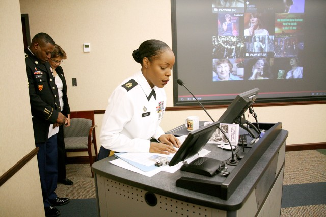 Sgt. 1st Class Frenchshella Hall, chaplain assistant, U.S. Army Space and Missile Defense Command/Army Forces Strategic Command, provides the invocation at the beginning of the command's Women's History Month celebration at SMDC's Redstone Arsenal headquarters March 12.