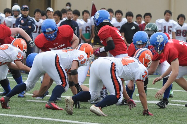 YOKOTA AIR BASE (March 13, 2013) -- Team USA routed Team Japan 57-21 at the second annual Tomodachi Bowl, an all-star high school football showcase, held March 10 at Bonk Field on Yokota Air Base. Team USA was comprised of players from Zama American, Yokota, Nile C. Kinnick, American School In Japan, Seoul American, Kubasaki and Kadena high schools. Team Japan consisted of players from Waseda and Hosei high schools. Team USA dominated on both sides of the field, leading 35-7 at the half. Contributing to Team USA's overall score was a touchdown run from ZAHS' Mitchell Harrison.