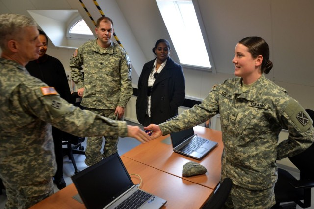 Lt. Gen. Donald M. Campbell Jr., U.S. Army Europe commander, discusses Sgt. Megan Loveland's plans after the Army during a chat at U.S. Army Garrison Kaiserslautern's new transition center on Kleber Kaserne.