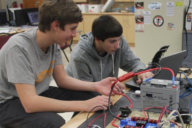 Two students go through the paces of testing their robotic creation. The initiative to encourage student interest in technical fields is under the auspices of the Armament Research, Development and Engineering Center at Picatinny Arsenal, N.J.