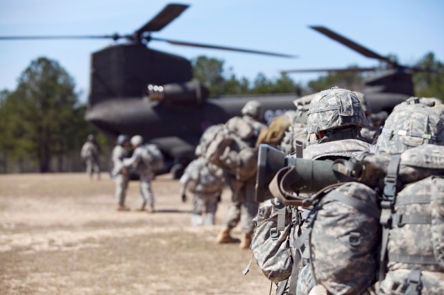 Ranger students prepare to board a helicopter Thursday at Camp Darby.  The flight was part of the first joint training exercise between the MCoE and the Aviation Center of Excellence at Fort Rucker, Ala.