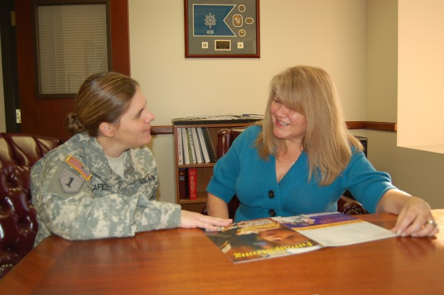 Phoenix Recruiting Battalion Soldier and Family Assistance Program Manager Dena Hallman talks with Battalion Commander Lt. Col. Jennifer McAfee about services for their geographically dispersed families.