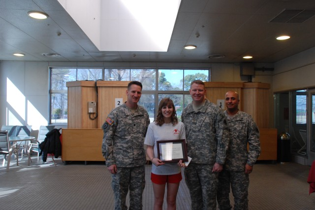 Members of the 35th Combat Sustainment Support Battalion command group award Somers Overly a Certificate of Appreciation March 12 at Yano Fitness Center for performing duties March 5 that led to rescuing a drowning Soldier.