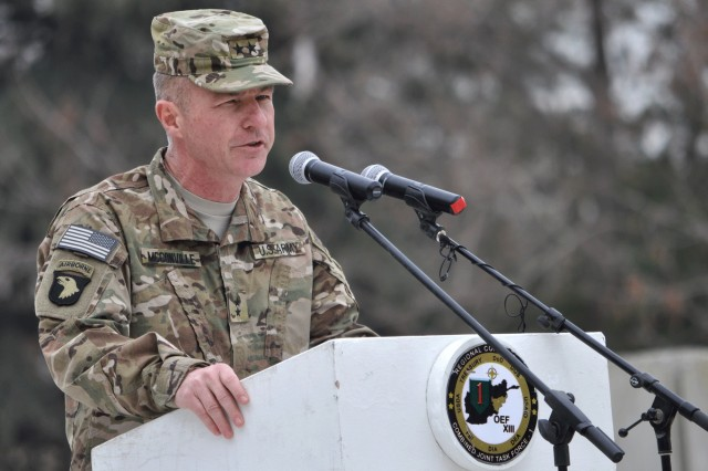 Maj. Gen. James C. McConville, commander of the 101st Airborne Division (Air Assault) and Combined Joint Task Force-101, addresses the audience at a transfer-of-authority ceremony at Bagram Airfield, Afghanistan, March 14, 2013. The 101st Airborne Division assumed control of Regional Command-East from the 1st Infantry Division.
