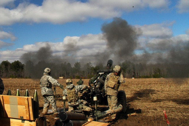 FORT CAMPBELL, Ky. - The round of a M119 105mm Howitzer heads to its target just split-seconds after it was fired by Currahees with 4th Battalion, 320th Field Artillery Regiment, 4th Brigade Combat Team, 101st Airborne Division, on Mar. 6, 2013 at Fort Campbell, Ky.