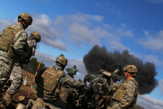 FORT CAMPBELL, Ky. - Smoke blasts out of the barrel of a M119 105mm Howitzer just split-seconds after it was fired by Currahees with 4th Battalion, 320th Field Artillery Regiment, 4th Brigade Combat Team, 101st Airborne Division, on Mar. 6, 2013 at Fort Campbell, Ky.