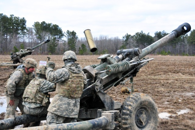 FORT CAMPBELL, Ky - A Soldier with 4th Battalion, 320th Field Artillery Regiment, 4th Brigade Combat Team, 101st Airborne Division, throws an empty canister over his shoulder while he and his team practice crew drills with their M119 105 mm Howitzer during a live-fire exercise Mar. 6, 2013 at Fort Campbell, Ky.