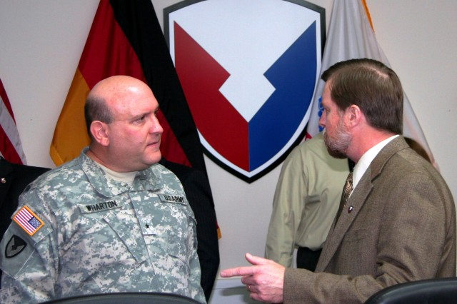 Brig. Gen. John Wharton, commanding general, Army Sustainment Command, and Stephen Lockridge, 405th Army Field Support Brigade deputy commander, confer at brigade headquarters in Kaiserslautern, Germany, Feb. 7. (Photo by Steven Stanfill, 405th AFSB Public Affairs)