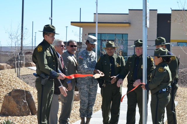 CLINT, TEXAS, -- Participants in the ribbon-cutting ceremony left to right: Border Patrol Agent Robert Crespo, Al Vasquez, Spawglass Contracting, Deputy Director Mr. Hector Montalvo, Lt. Col. Gant, Assistant Patrol Agent in Charge Donald B. Lucero, Chief Patrol Agent Scott A. Luck, Border Patrol Agent Victor Loya, and Border Patrol Agent Tessa Reyes.