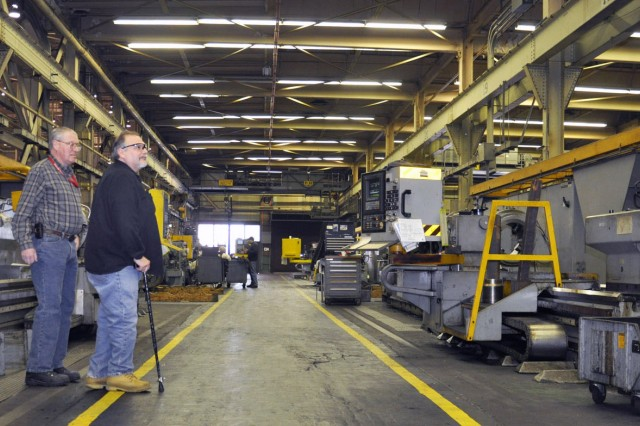Modern technology has enabled materiel to be produced in fewer and smaller facilities, resulting in potential savings to the Army. Here, workers at Watervliet Arsenal, N.Y., inventory equipment for possible replacement.