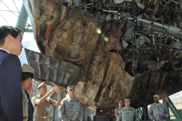 Eighth Army Commanding General Lt. Gen. John D. Johnson (center) visits the wreckage of the Republic of Korea Ship Cheonan, in September 2012.