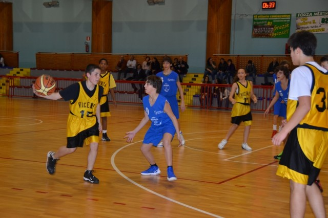 The Mestrino Raptors (in blue) work for an opening to the basket against the Vicenza CYSS Yellow Jackets defense during a re-match at the Lissaro Gym Feb. 27.