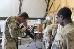 4th Brigade, 2nd Infantry Division Brigade Soldiers perform small arms weapons reset in theater