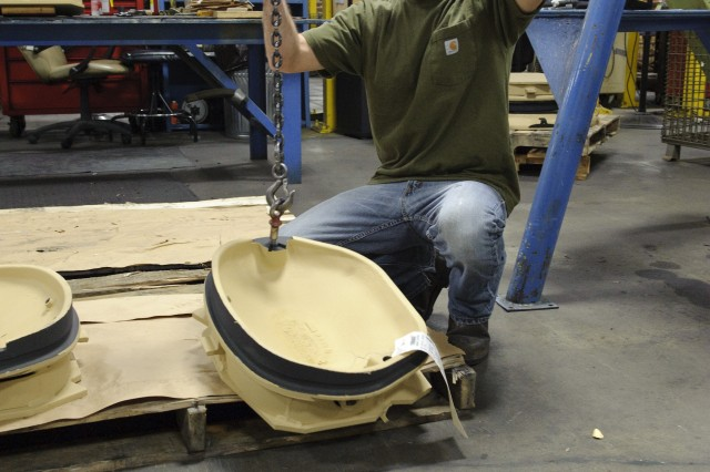Tim Alsup lifts a tank component using a jib boom in Anniston Army Depot's Nichols Industrial Complex. Mechanical lifting devices, such as the boom, can prevent overexertion injuries.