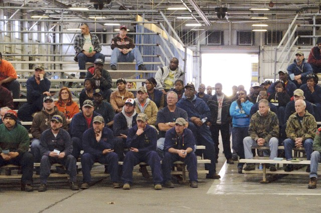 Employees in Anniston Army Depot's Nichols Industrial Complex participate in one of the three town hall meetings held on the installation this week.