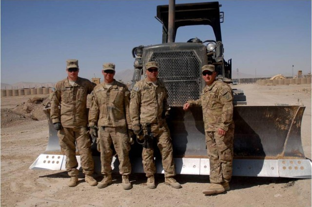 Spc. Joshua Vermote, Spc. Wesley Berry, Sgt. First Class Marold Mills and Sgt. Jay Scott, are the motor transport operators and manual work force behind the 1-41FA Traveling Transition Team, located in Zabul province, Afghanistan. The purpose of the T3 is to demilitarize and return southern Afghanistan's land back to the way it was prior to International Security Assistance Forces inhabitation. March 9. (U.S. Army Photo by 1st Lt. Vanessa Macekura)