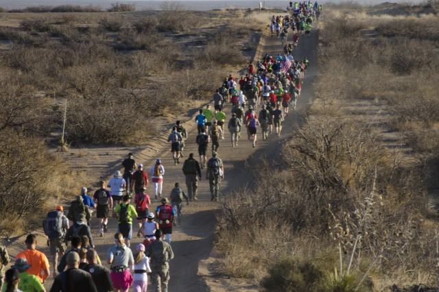 A sea of marchers make their way through the desert terrain near the three mile mark of the 26.2 mile Bataan Memorial Death March held at White Sands Missile Range, N.M. The marchers had an option to participate in the full 26.2 mile march or the honorary 14.2 mile march.