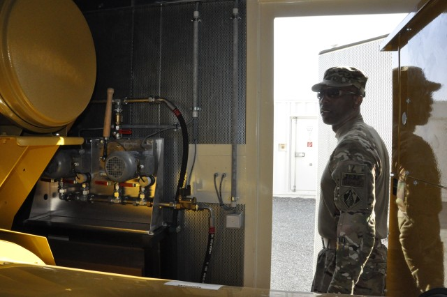 Chief Warrant Officer 4 Keith Wright, the district's Prime Power liaison, inspects generators and facilities at Bagh-e-Pol, Afghanistan.