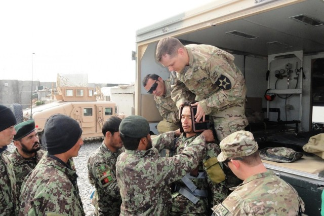 Staff Sgt. Walter C. Hickman instructs Afghan Soldiers on equipment from their ambulance Jan. 10 on Forward Operating Base Zangabad in the Panjwa'i District of Afghanistan. Hickman is a Medic Mentor Noncommissioned Officer assigned the Security Force Assistance Team of 4th Battalion, 9th Infantry Regiment, Combined Task Force 4-2 (4th Stryker Brigade Combat Team, 2nd Infantry Division). (U.S. Army photo by Staff Sgt. Jose Martinez-Velez)