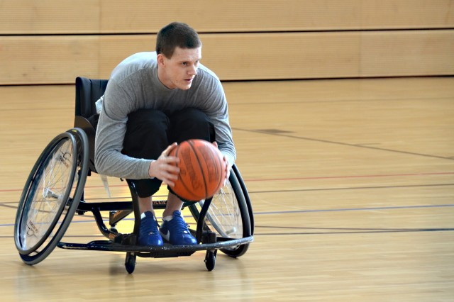 Sgt. Daniel Penvose, Warrior Transition Battalion-Europe, dribbles the ball down the court during an adaptive sports event in Grafenwoehr, Germany, March 14, 2013.