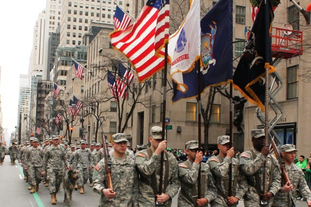 The color guard of the 1st Battalion 69th Infantry, leads the way as 750 Soldiers and guests lead the New York City St. Patrick's Day Parade up 5th Avenue, March 16, 2013. The Soldiers of the New York Army National Guard battalion have led what has become the world's largest St. Patrick's Day event every year since 1851.