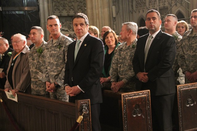 "New York Gov. Andrew Cuomo joins Maj. Gen. Patrick Murphy, the adjutant general of New York (on the governor's right), and Lt. Col. James Gonyo, the commander of the 1st Battalion, 69th Infantry, and other members of the 1st Battalion, 69th Infantry, in a special St. Patrick's Day Mass at St. Patrick's Cathedral, March 16, 2013. Gen. Frank Grass, the chief of the National Guard Bureau, is behind the governor. Following the service the Soldiers of the ""Fighting 69th"" led the St. Patrick's Day Parade -- the world's largest such event -- as they have every year since 1851."