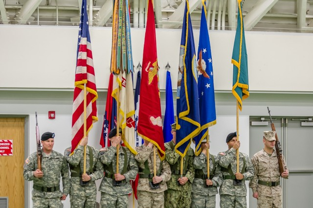 The Noncommissioned Officers Academy joint services color guard provides honors during the change-of-responsibility ceremony held March 11 at Nutter Field House for the Maneuver Support Center of Excellence and Fort Leonard Wood's top noncommissioned officer.
