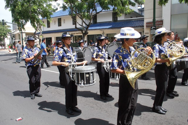 A marching band prepares to perform for bystanders during the Prince Kuhio Parade along Kalakaua Avenue, March 24, 2012.