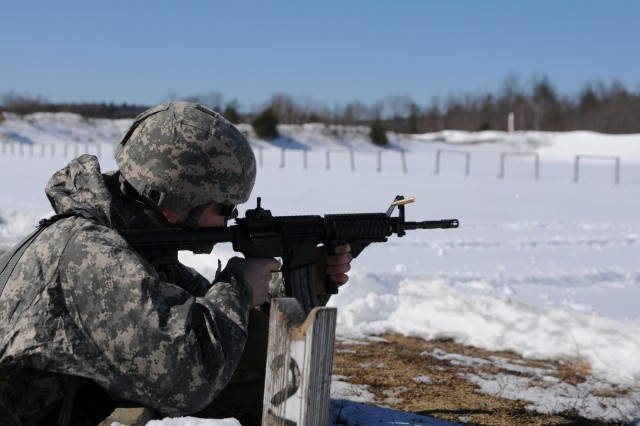 Spc. Austin Rosende, the 368th Engineer Battalion's Best Warrior Competition junior enlisted winner, fires at multiple targets as part of the marksmanship portion of the competition during the event held at Fort Devens, Mass. 8-10 March, 2013. The battalion-level competition selects the best NCOs and Soldiers who will participate in the 412th Theater Engineer Command BWC in April.