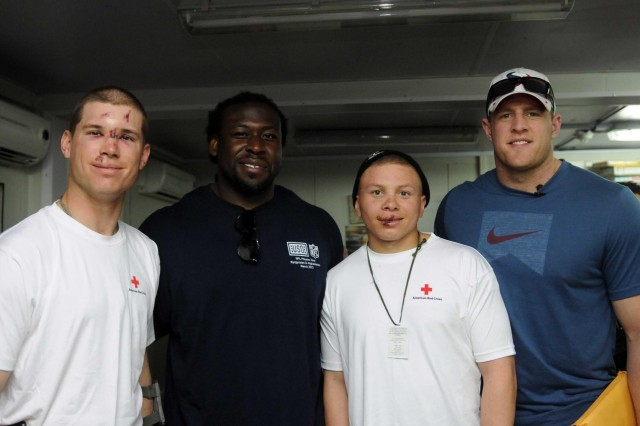 """Davin Joseph and Justin James """"J.J."""" Watt visits troops at the Warrior Recovery Center in Regional Command-South, Afghanistan, March 18, 2013."""
