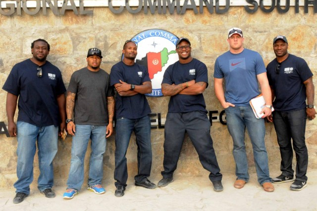 """Davin Joseph, Stevonne Latrall Smith, Roland """"Champ"""" Bailey, Von Miller, Justin James """"J.J."""" Watt and D'Qwell Jackson, visit Regional Command-South, Afghanistan, March 18, 2013. This is the first USO tour for the National Football League players."""