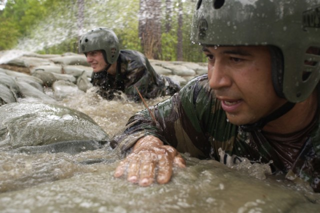 """In this undated file photo, candidates in the Special Forces Assessment and Selection course are put to the test on the """"Nasty Nick"""" obstacle course at Camp Mackall, N.C. SFAS is a 24-day, live-in course and serves as the first phase in the Special Forces Qualification Course. Because of the course's tough training standards, few who attend SFAS will ultimately earn the green beret."""