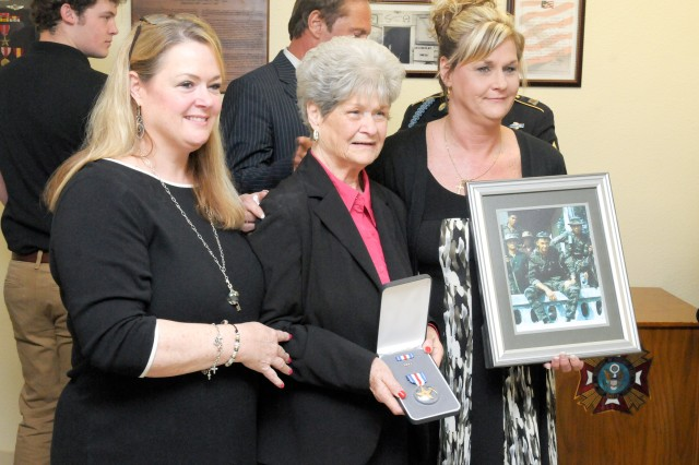 Betty Snowden, center, wife of the late Master Sgt. Ben Snowden, poses for a photo with her daughters, Sharla Green, left, and Lisa Conner, in an awards ceremony in her husband's honor at the Ben D. Snowden Veterans of Foreign Wars Post 8587 in Georgetown, Texas, March 16. Snowden was awarded the Silver Star for acts of valor during his service in the Vietnam War. (Photo by Staff Sgt. Tony Foster, Division West Public Affairs)
