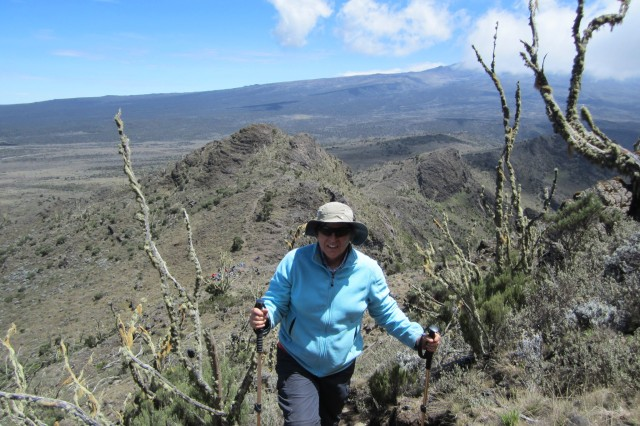 Bev Stotz maneuvers the rocky terrain of Lava Tower during her January climb of Mount Kilimanjaro.