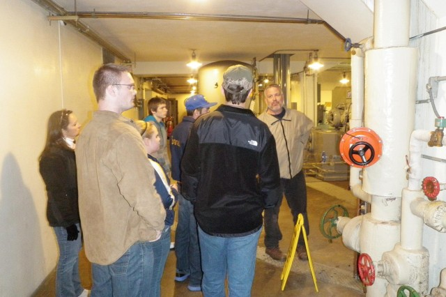 Ben Bremer gives a group of Mountain Home High School students a tour of the Norfork Dam hydropower plant as part of the school's annual mentorship field day