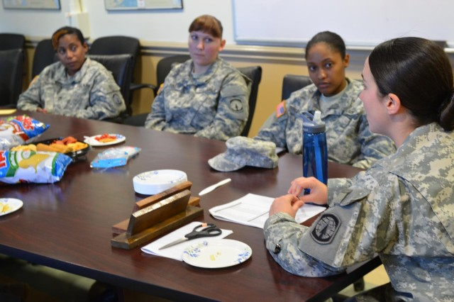 Capt. Marissa F. Ballesteros, commander, 21st Military Police Company, 503rd MP Battalion, 16th MP Brigade meets with her group of mentees during a monthly small group meeting Feb. 27 at Fort Bragg, N.C. These meetings, a central part of the brigade's Women in Uniform Mentorship Program, are designed to facilitate easy discourse between mentors and their mentees.