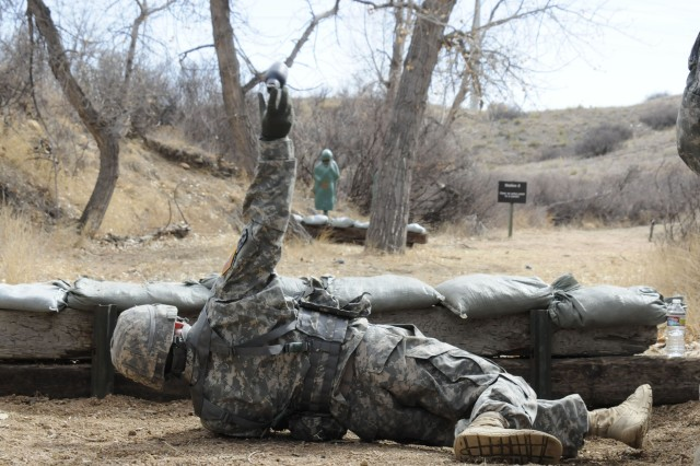 Soldiers of the 100th Missile Defense Brigade try their hand at throwing inert grenades at the qualification range on Fort Carson, Colo., during the unit's field training exercise March 7.