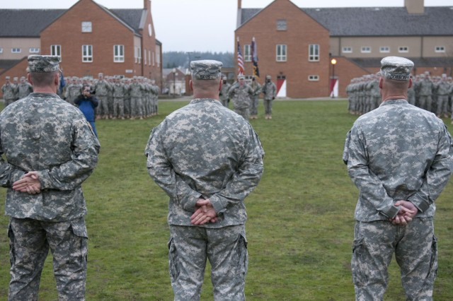Command Sgt. Maj. Timothy Dotson (right), outgoing command sergeant major for the 1st Battalion, 17th Infantry Regiment, 2nd Stryker Brigade Combat Team, 2nd Infantry Division, stands beside Lt. Col. Timothy Davis (center), commander of 1-17 Inf., and Command Sgt. Maj. Jeffery Stone (left), incoming command sergeant major, for a change of responsibility ceremony, March 14, at Joint Base Lewis-McChord, Wash. Dotson will be assuming responsibility for the 2nd SBCT, 2nd Inf. Div., which oversees six battalions to include 1-17 Inf., April 25. (Photo by Sgt. Matt Kuzara, 2nd Bde., 2nd Inf. Div.)